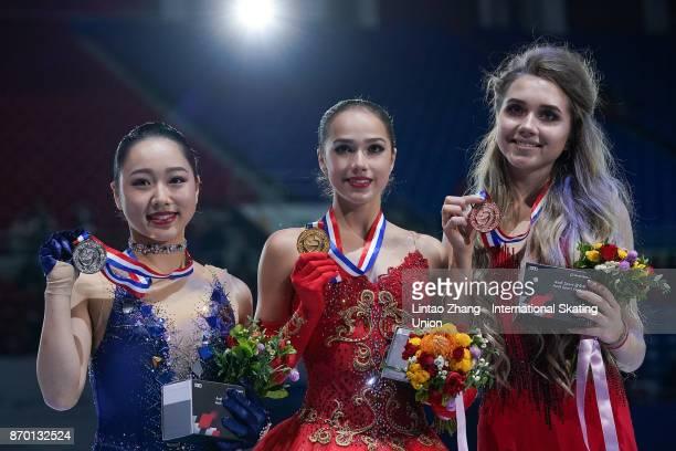First place winner Alina Zagitova of Russia second place winner Wakaba Higuchi of Japan and third place winner Elena Radionova of Russia pose on the...