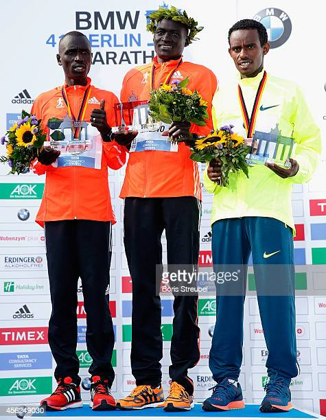 First place winner and new world record holder Dennis Kimetto of Kenya poses with second place winner Emmanuel Mutai of Kenya and third place winner...