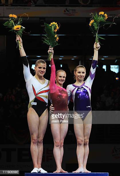 First place winner Anna Dementyeva of Russia secondplace winner Elisabeth Seitz of Germany and thirdplace winner Elena Amelia Racea of Romania pose...