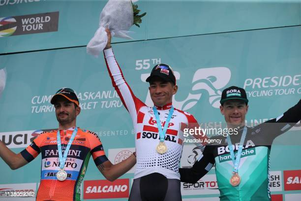 First place winner Australia's Juan Caleb Ewan , riding for the Lotto Soudal team, second place winner Spain's Juan Jose Lobato , riding for the...