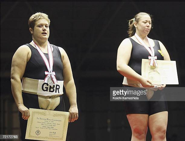 First place winner Auua Zhigalova of Russia and second place winner Adele Jones of England pose after competing in the women's Open Division during...