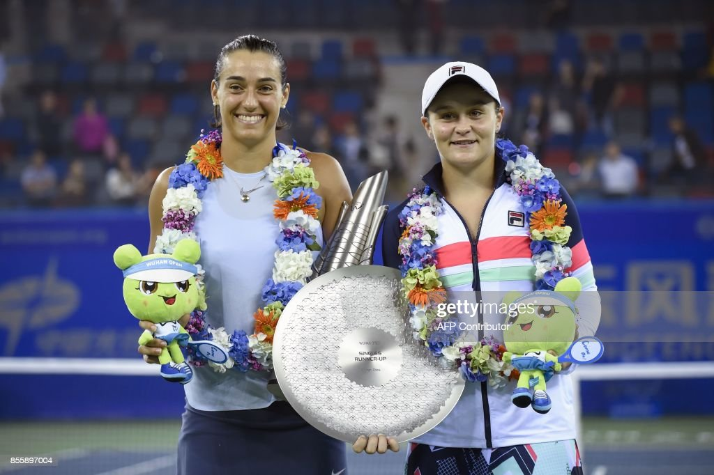 First place winner Caroline Garcia of France (L) and second place Ashleigh Barty of Australia at the women's singles final match at the WTA Wuhan Open tennis tournament in Wuhan, in China's central...