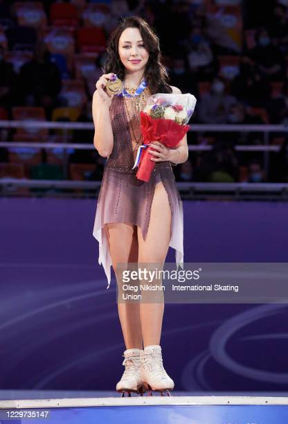 First place winner Elizaveta Tuktamysheva of Russia shows her medal during the medals ceremony on day three of the ISU Grand Prix of Figure Skating...