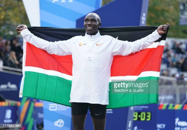 First place winner Geoffrey Kamworor of Kenya poses during the 2019 TCS New York City Marathon in New York on November 3 2019 Geoffrey Kamworor and...