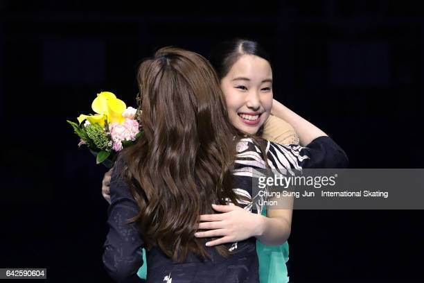 First place winner Mai Mihara of Japan hugs with Yuna Kim during a medals ceremony of the Ladies skating during ISU Four Continents Figure Skating...