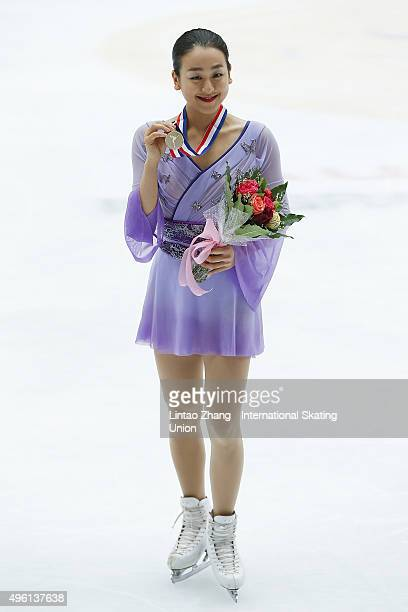 First place winner Mao Asada of Japan pose on the podium after the medals ceremony of the Ladies Short Program on day two of Audi Cup of China ISU...