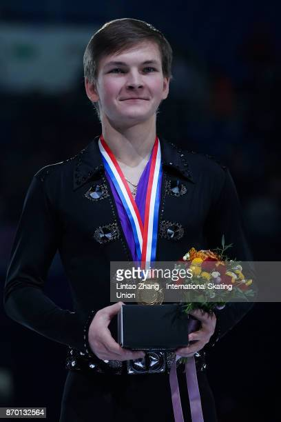 First place winner Mikhail Kolyada of Russia poses on the podium during the medals ceremony on day two of Audi Cup of China ISU Grand Prix of Figure...