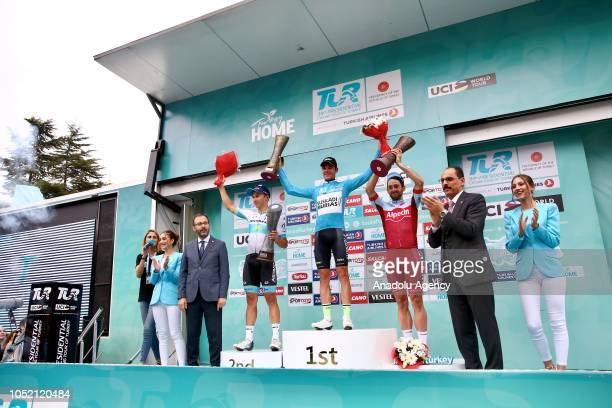 First place winner Spain's Eduard Prades Reverter who rides for the Euskadi Basque CountryMurias team the second place winner Kazakhistani Alexey...