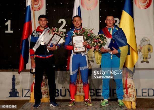 First place winner Stanislav Titorenko of Russia second place winner Vadym Luchynskyi of Ukraine and third place winner Eugene Rabtsevich of Russia...