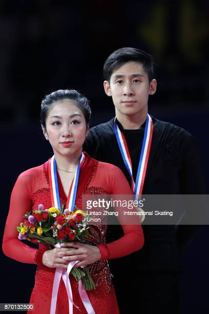 First place winner Sui Wenjing and Han Cong of China pose on the podium during the medals ceremony of the pairs free Skating on day two of Audi Cup...