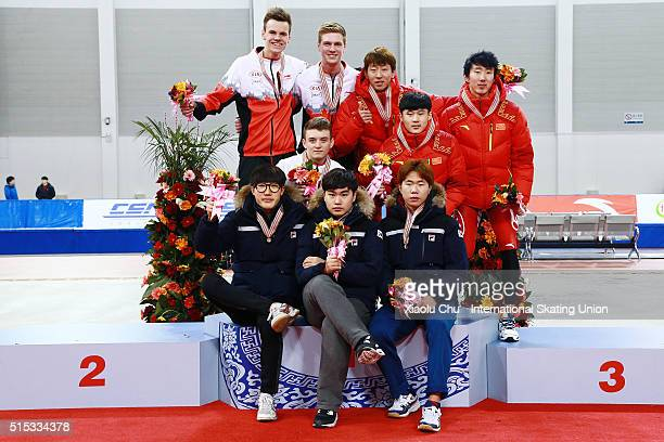 First place winner team of Korea second place winner team of Canada and third place winner team of China pose for photo on the podium after the Men...