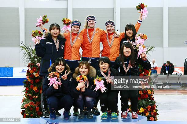 First place winner team of Netherlands second place winner team of Korea and third place winner team of Japan pose for photo on the podium after the...