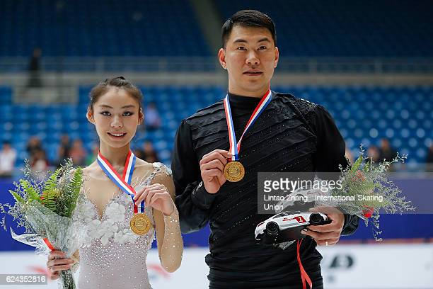 First place winner Yu Xiaoyu and Zhang Hao of China pose on the podium during the medals ceremony of the Pairs Free Skating on day two of Audi Cup of...