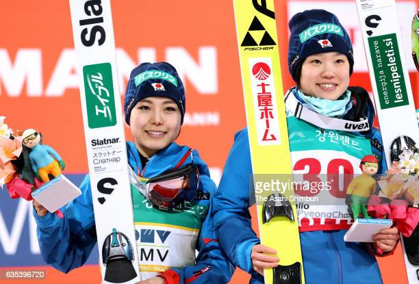 First place Yuki Ito and second place Sara Takanashi of Japan celebrate on the podium at the award ceremony for the Ladies Normal Hill during day one...