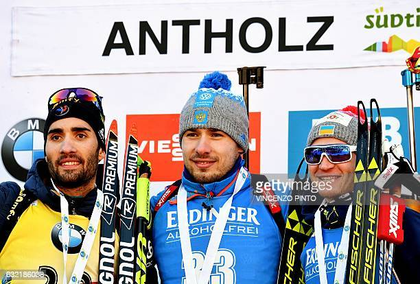 First placed Anton Shipulin of Russia poses with second placed Martin Fourcade of France and third placed Sergey Semenov of Ukraine during the podium...