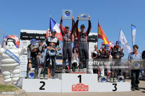 First placed Belgium driver Thierry Neuville and copilot Nicolas Gilsoul of Hyunday Motorsport team celebrate next to Second placed French driver...