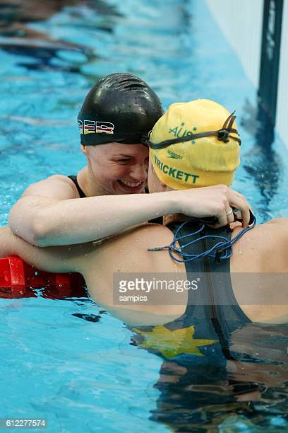 First placed Britta Steffen from Germany embraces second placed Lisbeth Trickett from Australia after the women's swimming 100m freestyle final at...