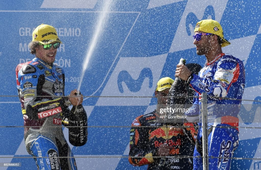 First placed EG 0,0 Marc VDS' Italian rider Franco Morbidelli (L), second placed Italtrans Racing Team's Italian rider Mattia Pasini (R) and third placed red Bull KTM Ajo's Portuguese rider Miguel Oliveira celebrate on the podium after the MOTO 2 race of the Moto Grand Prix of Aragon at the Motorland circuit in Alcaniz on September 24, 2017. /