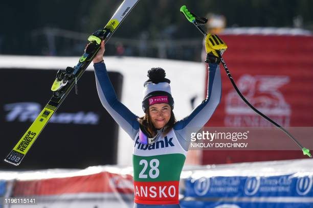 First placed Elena Curtoni of Italy celebrates as she arrives on the podium after winning the ladies' downhill event at the FIS ski alpine World Cup...