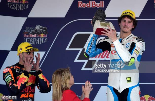 First placed Forward Team's Italian rider Lorenzo Baldassarri celebrates on the podium beside second placed Leopard Racing's Portuguese rider Miguel...