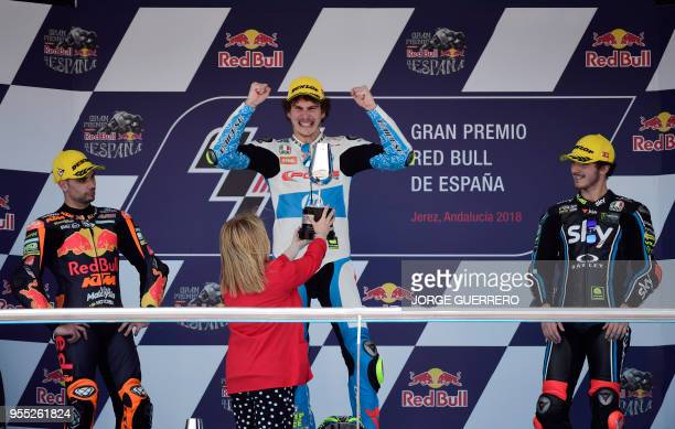First placed Forward Team's Italian rider Lorenzo Baldassarri second placed Leopard Racing's Portuguese rider Miguel Oliveira and third placed SKY...