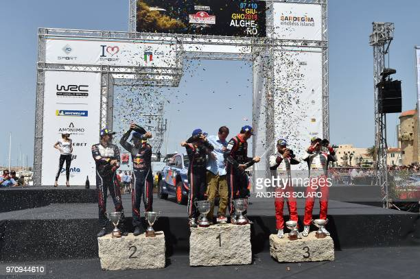 First placed French driver Sebastien Ogier and codriver Julien Ingrassia of Ford Fiesta WRC second placed Belgium's driver Thierry Neuville and...