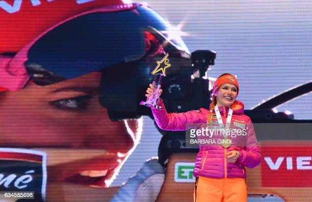 First placed Gabriela Koukalova of the Czech Republic poses at the winners ceremony after the Ladies-Sprint competition of the Biathlon World...