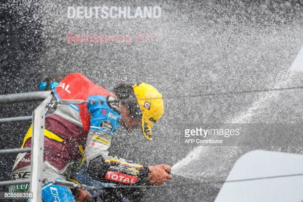 TOPSHOT First placed Italian Kalex rider Franco Morbidelli celebrates winning the Moto2 competition of the Moto Grand Prix of Germany at the...