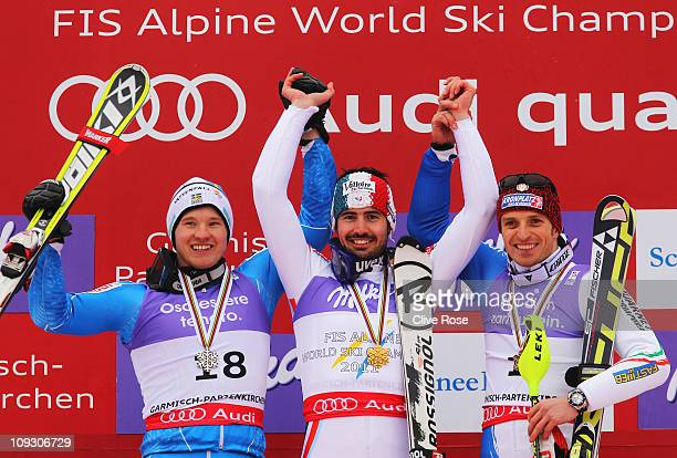 First placed JeanBaptiste Grange of France celebrates with second placed Jens Byggmark of Sweden and third placed Manfred Moelgg of Italy at the...