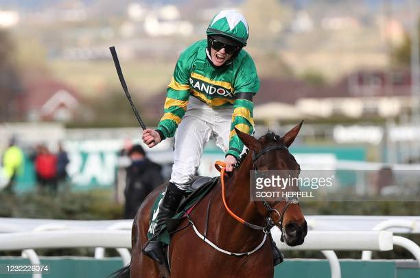 First placed Jockey Rachael Blackmore rides 'Minella Times' to win the Grand National Hanidcap Chase on Grand National Day of the Grand National...
