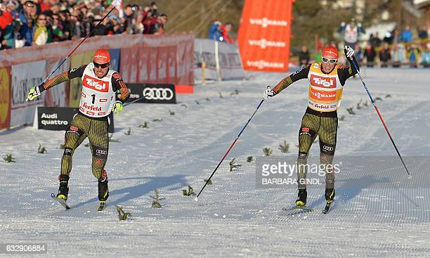 First placed Johannes Rydzek of Germany and second placed Eric Frenzel of Germany react in the finish area of the 10km competition of the Men's...