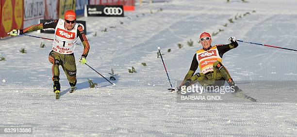 First placed Johannes Rydzek of Germany and second placed Eric Frenzel of Germany compete during the 10km competition of the Men's Nordic Combined...
