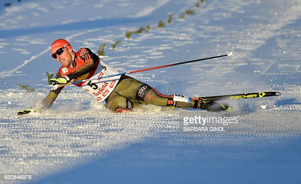 First placed Johannes Rydzek of Germany reacts in the finish of the 5km Gundersen competition of the Men's Nordic Combined FIS World Cup in Seefeld...