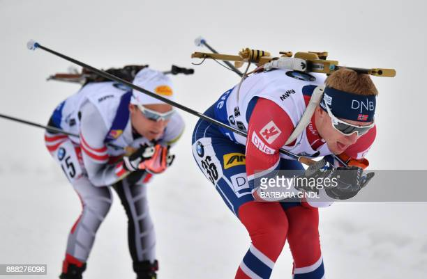 First placed Johannes Thingnes Boe of Norway and Felix Leitner of Austria compete during the men's 10 km sprint event at the IBU World Cup Biathlon...