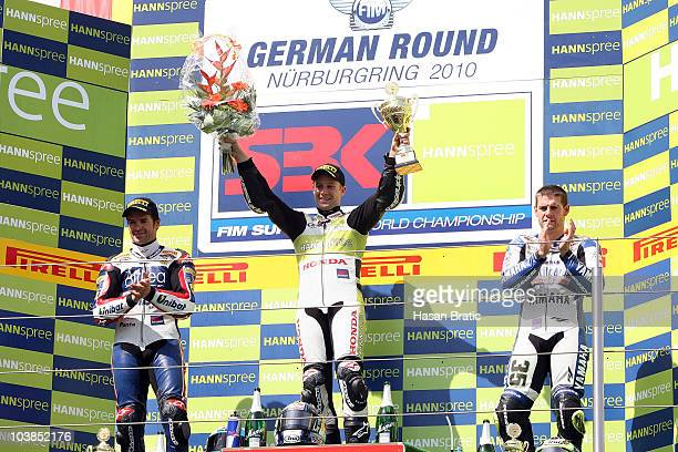 First placed Jonathan Rea of England and HANNspree Ten Kate Honda celebrates on the podium together with second placed Carlos Checa of Spain and...