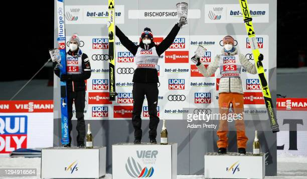 First placed Kamil Stoch of Poland celebrates with second placed Marius Lindvik of Norway and third placed Karl Geiger of Germany after the final...