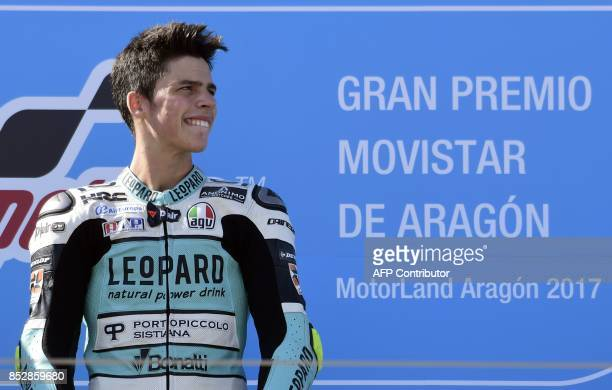 First placed Leopard Racing's rider from Spain Joan Mir stands on the podium after the MOTO 3 race of the Moto Grand Prix of Aragon at the Motorland...