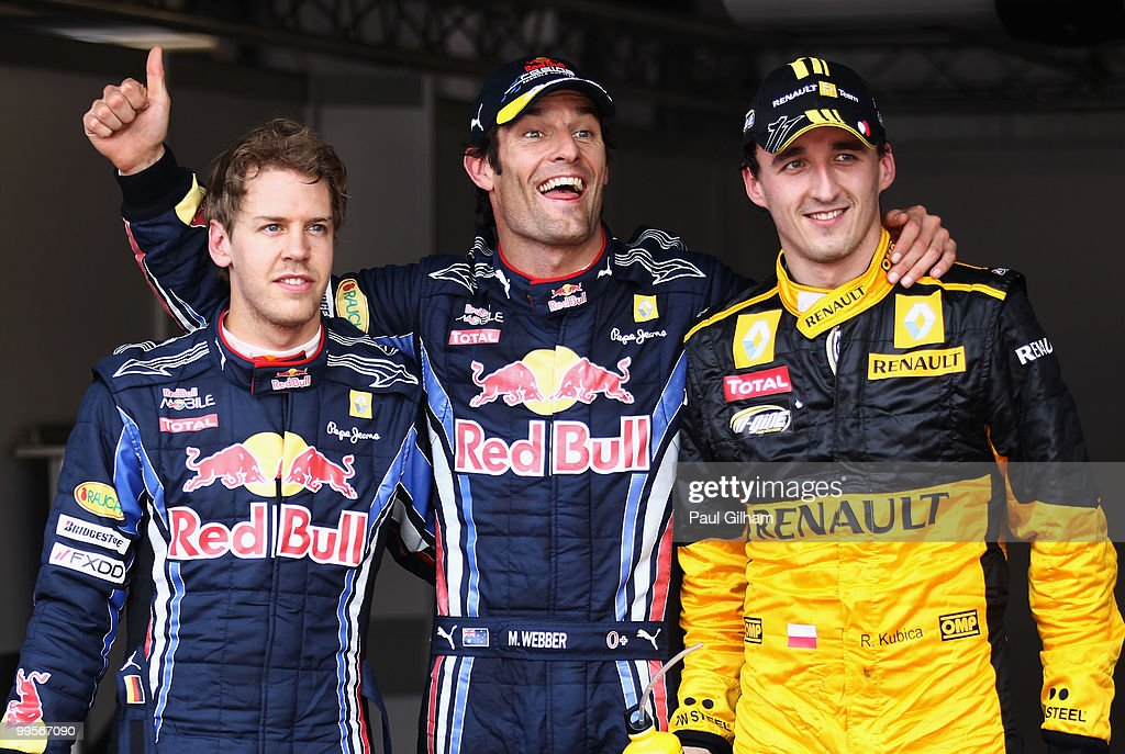 First placed Mark Webber (C) of Australia and Red Bull Racing celebrates in parc ferme with second placed Robert Kubica (R) of Poland and Renault and third placed Sebastian Vettel of Germany and Red Bull Racing following qualifying for the Monaco Formula One Grand Prix at the Monte Carlo Circuit on May 15, 2010 in Monte Carlo, Monaco.