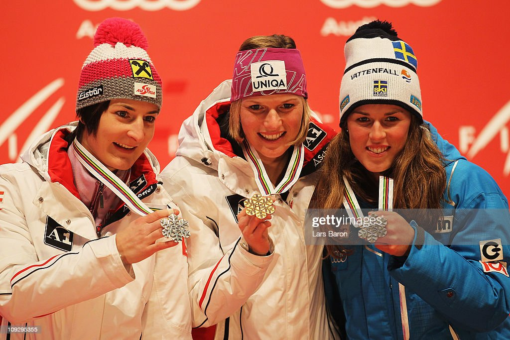 First placed Marlies Schild (C) of Austria, second placed Kathrin Zettel (L) of Austria and third placed Maria Pietilae-Holmner (R) of Sweden celebrate at the medal plaza after the Women's Slalom during the Alpine FIS Ski World Championships on the Gudiberg course on February 19, 2011 in Garmisch-Partenkirchen, Germany.