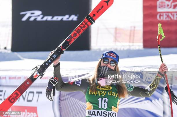 First placed Mikaela Shiffrin of US celebrates as she arrives on the podium after the ladie's downhill event at the FIS ski alpine World Cup in...