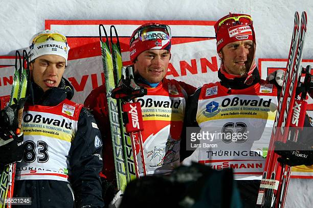 First placed Petter Northug of Norway 2nd placed Marcus Hellner of Sweden and 3rd placed Axel Teichmann of Germany pose after the Men's 37km Prologue...