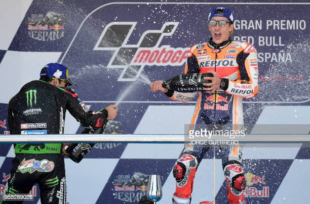 First placed Repsol Honda Team's Spanish rider Marc Marquez and second placed Monster Yamaha Tech 3's French rider Johann Zarco celebrate on the...