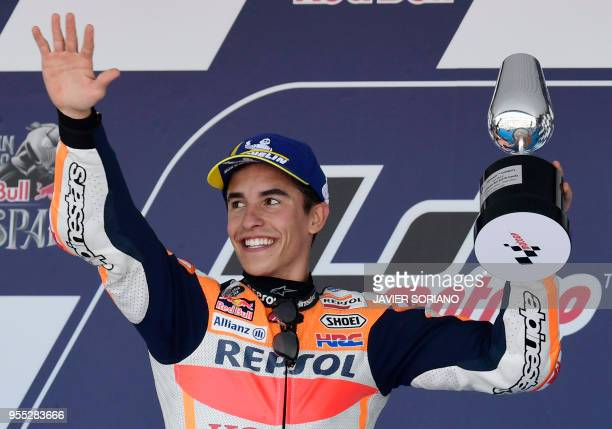 First placed Repsol Honda Team's Spanish rider Marc Marquez celebrates on the podium after the MotoGP race of the Spanish Grand Prix at the Jerez...