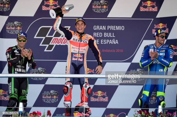 TOPSHOT First placed Repsol Honda Team's Spanish rider Marc Marquez second placed Monster Yamaha Tech 3's French rider Johann Zarco and third placed...