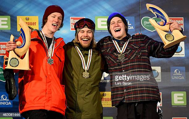 First placed Roope Tonteri of Finland poses with second placed Darcy Sharpe of Canada and third placed Kyle Mack of USA after the Men's Big Air...