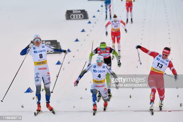 First placed Sweden's Linn Svahn second placed Natalia Nepryaeva of Russia and third placed Sweden's Jonna Sundling cross the finish line during the...
