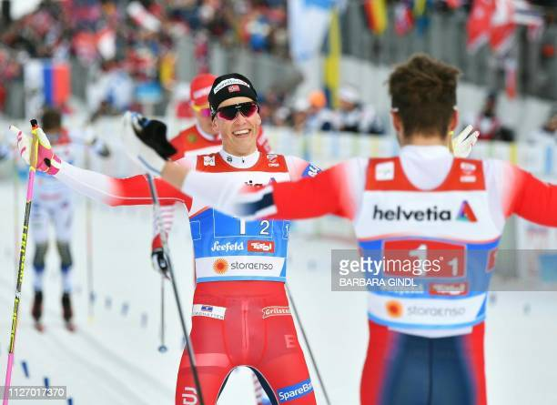 First placed team Johannes Hoesflot Klaebo and Emil Iversen of Norway celebrate after winning the men's team sprint final of the FIS Nordic World Ski...