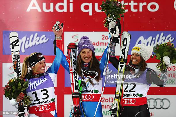 First placed Tina Maze of Slovenia celebrates at the flower ceremony with second placed Lara Gut of Switzerland and third placed Julia Mancuso of the...