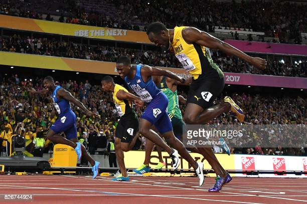 First placed US athlete Justin Gatlin, second placed US athlete Christian Coleman and third placed Jamaica's Usain Bolt compete in the final of the...