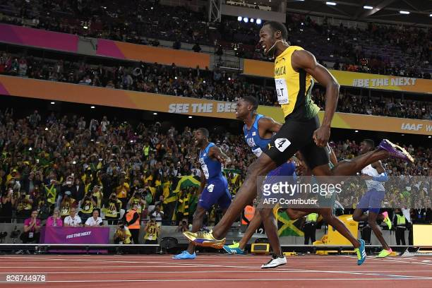 First placed US athlete Justin Gatlin second placed US athlete Christian Coleman and third placed Jamaica's Usain Bolt compete in the final of the...